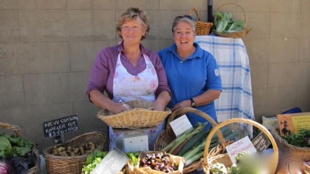 "Bronwyn and Helen selling their bountiful produce in ""Dojo Lane"""